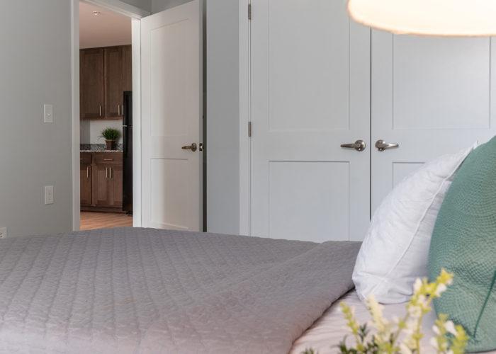 Bedroom, looking towards closet and door with view of kitchen