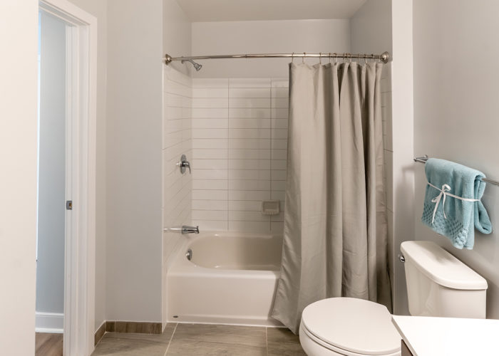 View of shower and toilet in bathroom
