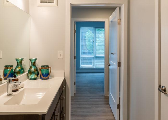 Bathroom, view of vanity, looking towards hallway and bedroom